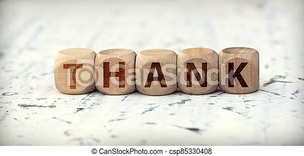 The word thank you on wooden cubes - csp85330408