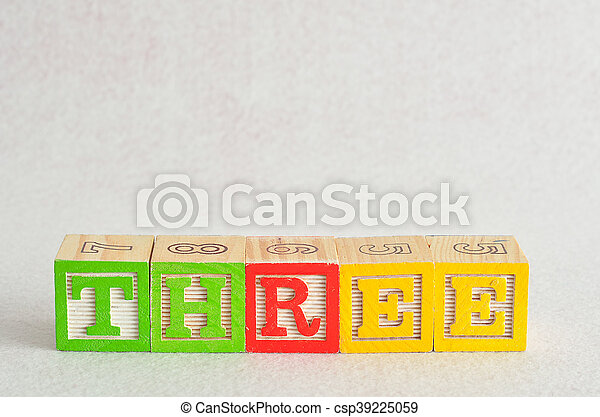 The word three (3) spelled with colorful alphabet blocks isolated against a white background - csp39225059