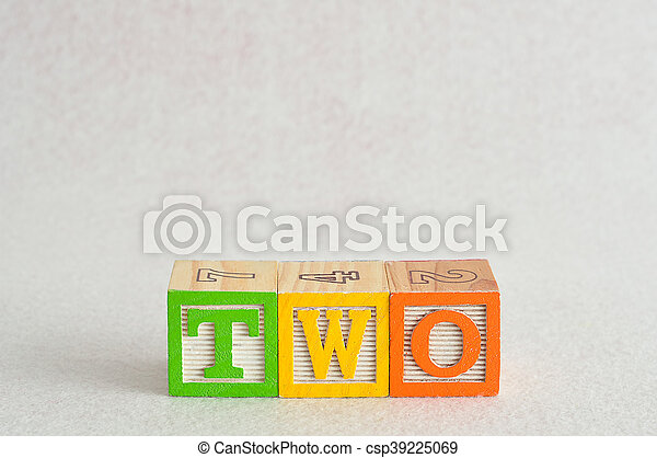 The word two (2) spelled with colorful alphabet blocks isolated against a white background - csp39225069