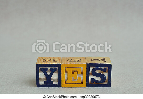 The word yes spelled with colorful alphabet blocks isolated against a white background - csp39330673