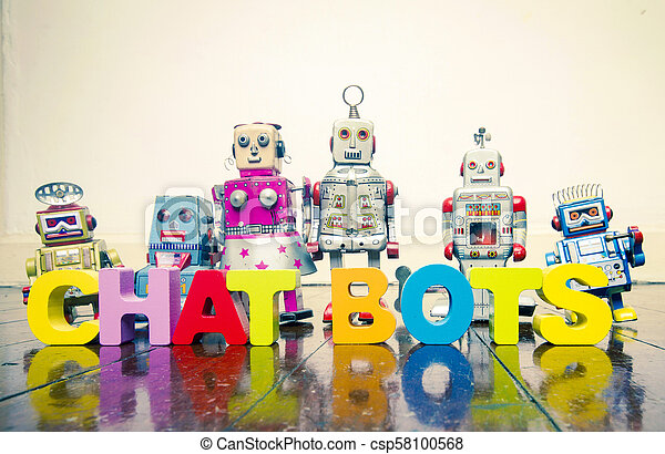 the words CHAT BOTS with wooden letters and retro toy robots on an old wooden floor - csp58100568
