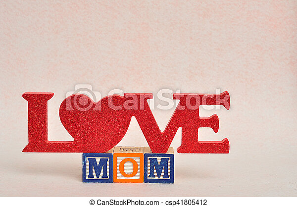 The words love mom spelled with alphabet blocks against a white background - csp41805412