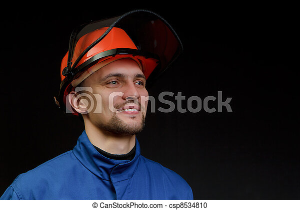 The worker in overalls and a helmet - csp8534810
