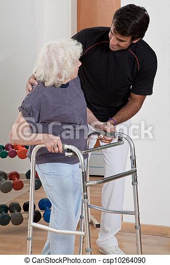 Therapist helping Patient use Walker - csp10264090