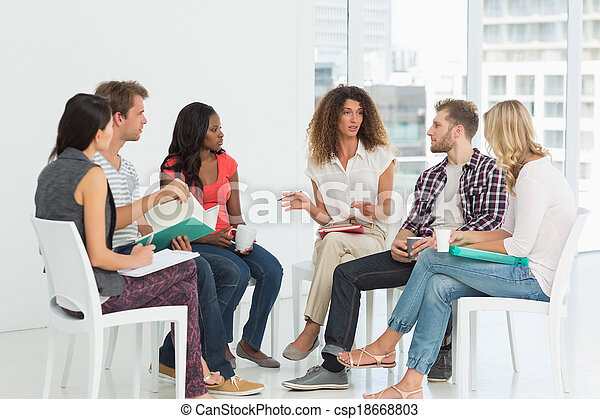 Therapist speaking to a rehab group - csp18668803