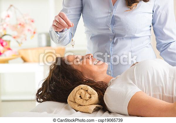 Therapist using pendulum - csp19065739