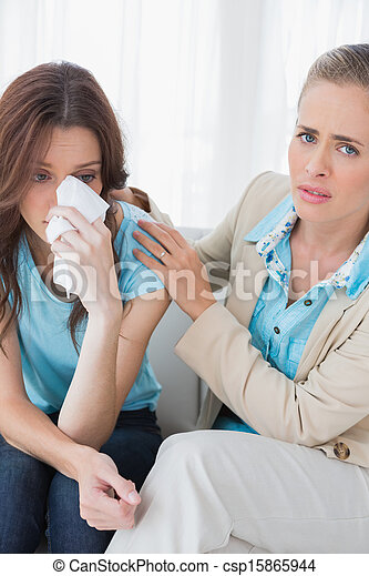 Therapist with her patient crying - csp15865944