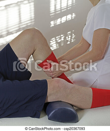 Therapist working on calf muscle - csp20367093