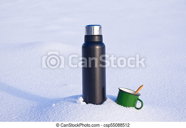 Thermos and mug in the snow - csp55088512