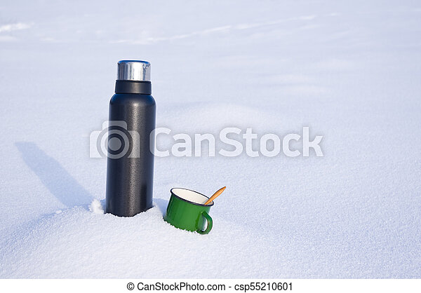 Thermos and mug in the snow - csp55210601