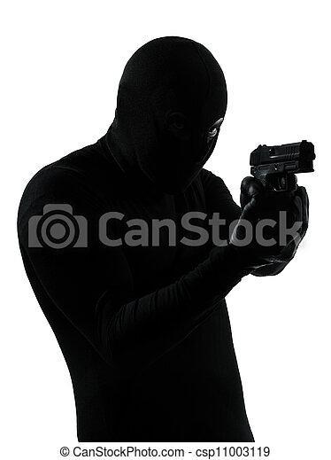 thief criminal terrorist holding gun portrait - csp11003119