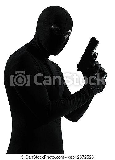 thief criminal terrorist holding gun portrait - csp12672526