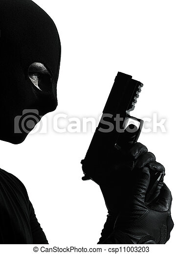 thief criminal terrorist holding gun portrait - csp11003203