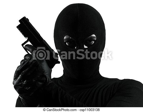 thief criminal terrorist holding gun portrait - csp11003138
