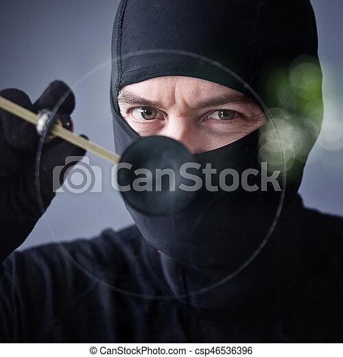thief in action - csp46536396