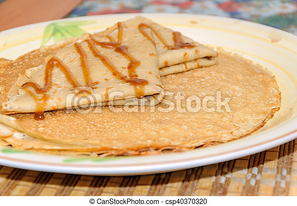 Thin russian pancakes on the plate. Maslenitsa is coming - csp40370320