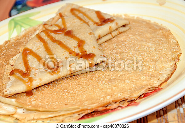 Thin russian pancakes on the plate. Maslenitsa is coming - csp40370326