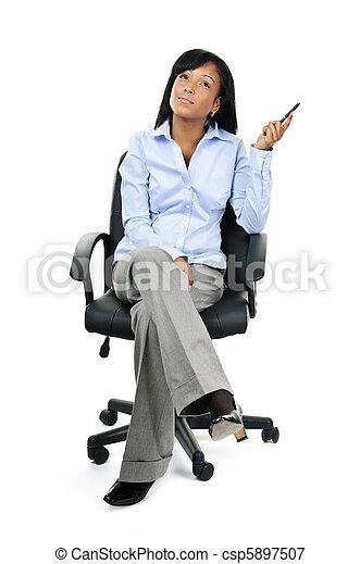 Thinking businesswoman sitting on office chair - csp5897507
