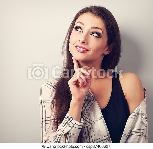 Thinking fun casual smiling young woman looking up. Toned closeup portrait - csp37400627
