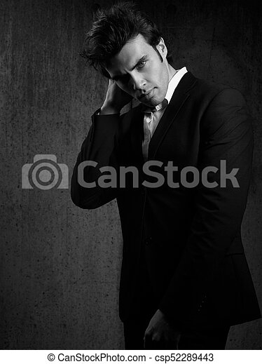 56853ab0 Thinking Handsome Male Model Posing In Blue Fashion Suit And White Style  Shirt Looking On Dark