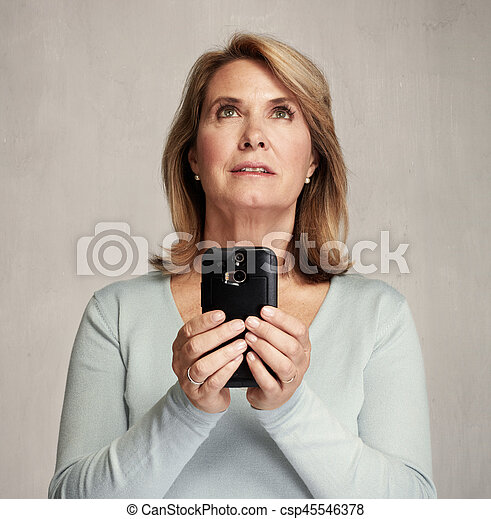 thinking woman with smartphone - csp45546378