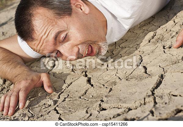 thirsty man in a desert - csp15411266