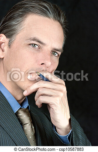 Thoughtful Businessman Looks To Camera - csp10587883