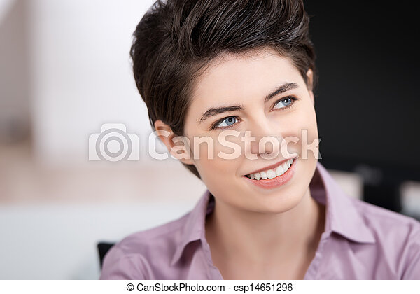 Thoughtful Businesswoman Looking Away While Smiling - csp14651296