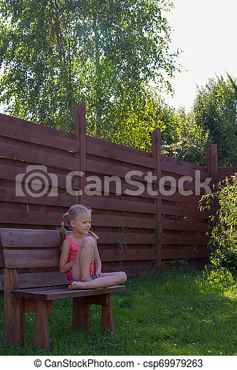 Pleasant Thoughtful Girl Sitting On Wooden Bench Ocoug Best Dining Table And Chair Ideas Images Ocougorg