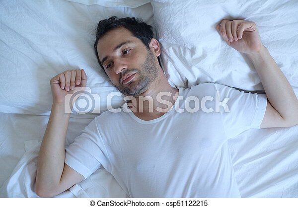 Thoughtful man cannot sleep because of insomnia - csp51122215