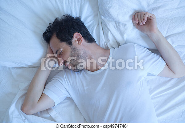 Thoughtful man cannot sleep because of insomnia - csp49747461