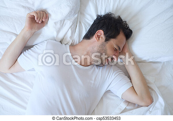 Thoughtful man cannot sleep because of insomnia - csp53533453