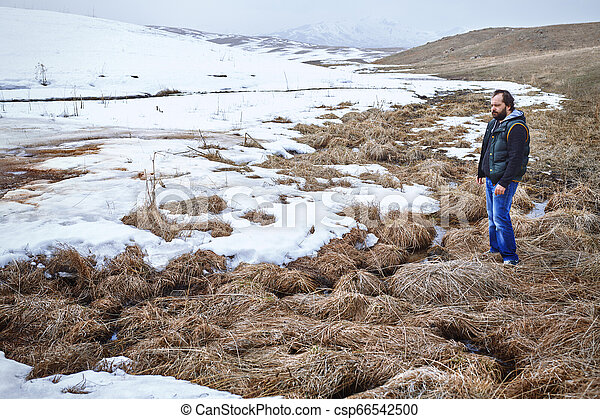 Thoughtful man in the winter landscape - csp66542500