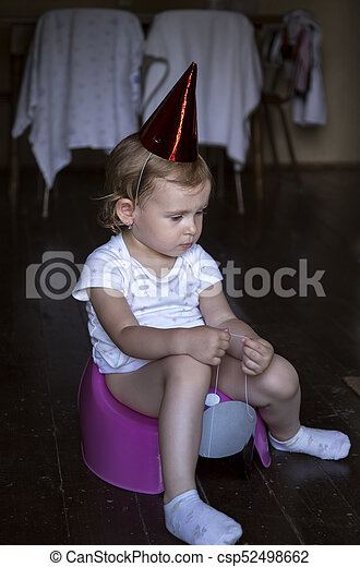 thoughtful sad child sitting on a potty - csp52498662