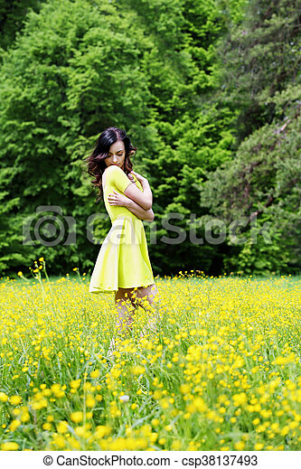 thoughtful woman in a meadow - csp38137493
