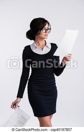 Thoughtful woman with papers standing on a white background - csp40197807