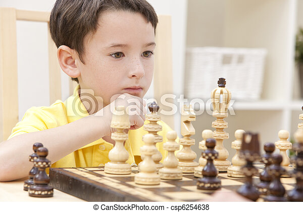 Thoughtful Young Boy Playing Chess - csp6254638