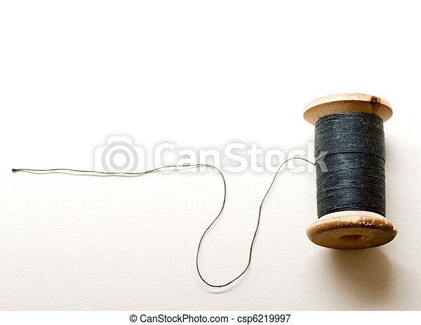 Thread bobbin on white background - csp6219997