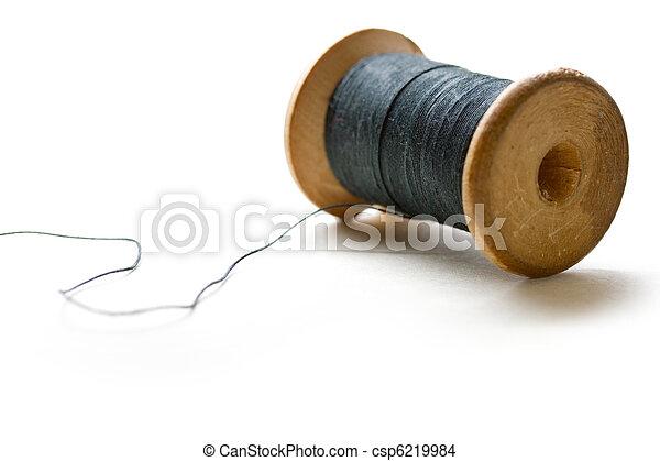 Thread bobbin on white background - csp6219984