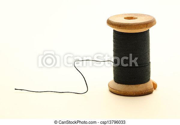 Thread bobbin on white background - csp13796033