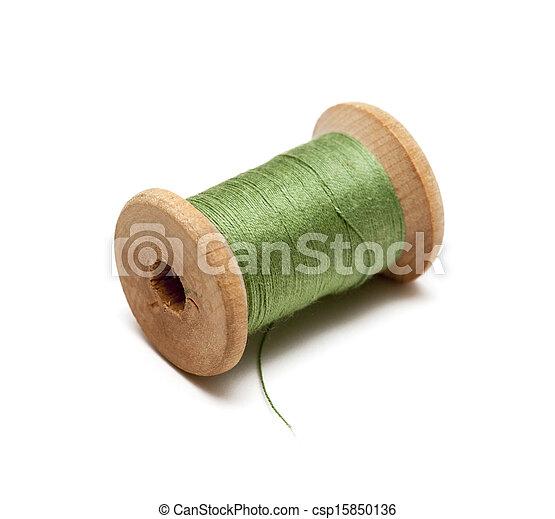 Thread bobbin on white background - csp15850136