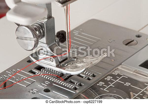 thread in needle of sewing machine closeup - csp6227199