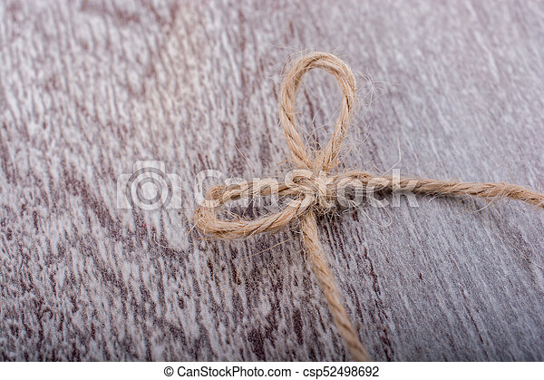Thread knot on a light color background - csp52498692