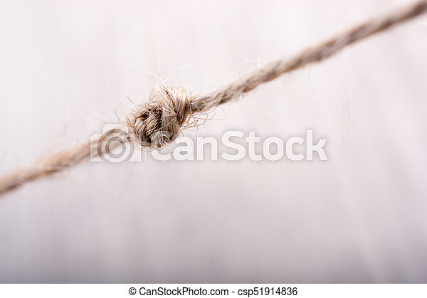 Thread knot on a light color background - csp51914836