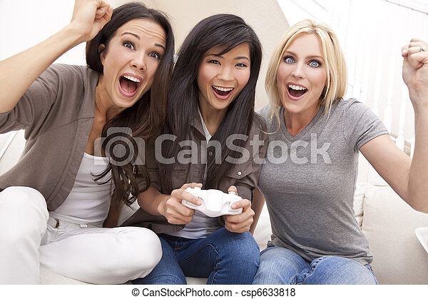 Three Beautiful Women Friends Playing Video Games at Home - csp6633818