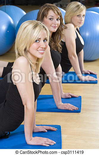 Three Beautiful Young Woman Aerobic Exercising At A Gym - csp3111419