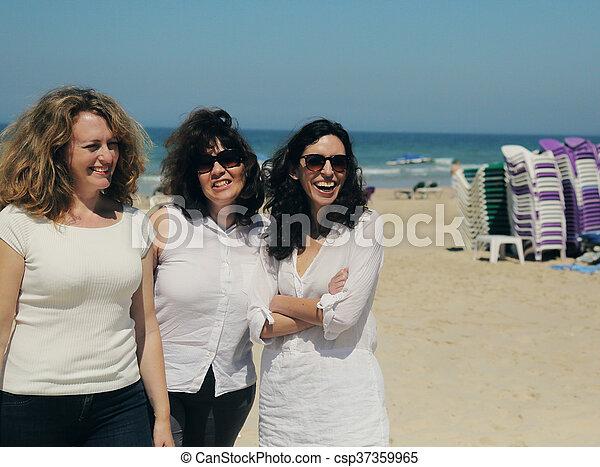 Three Best Friends Walking On The Seaside