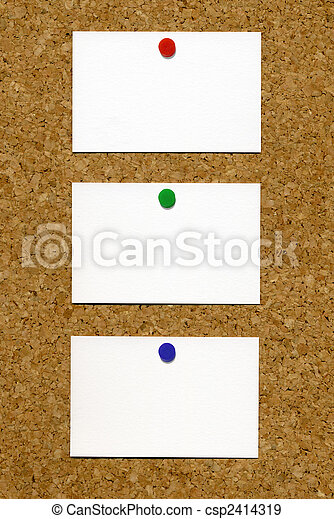 Three blank white business cards attached to a cork notice board colourmoves