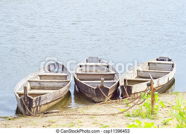 Three boats on coast of the river - csp11396453