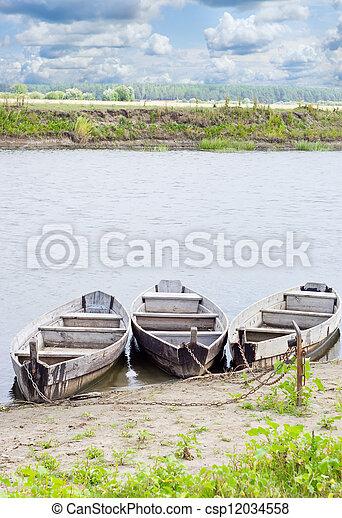 Three boats on coast of the river - csp12034558